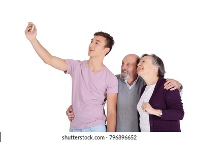 Grandparents and their teen grandson taking a selfie. Isolated on white background