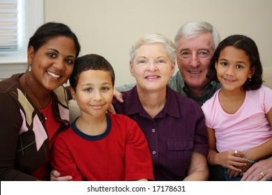 Grandparents together with their family at home