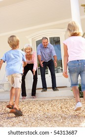 Grandparents Welcoming Grandchildren On Visit To Home