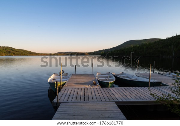Grands-Jardins national park, Canada - june 2020 : Rowing boats tied up at the quay of the Arthabaska lake