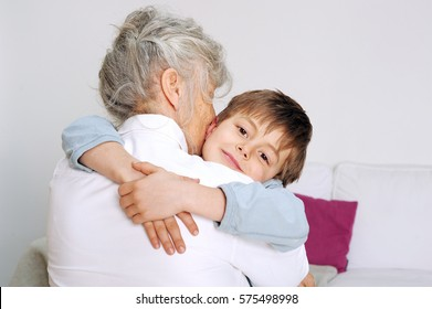 Grandson is giving his grandmother a big hug