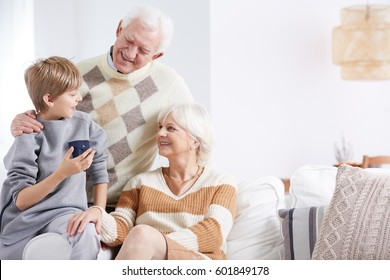 Grandson, grandma and grandpa spending time together
