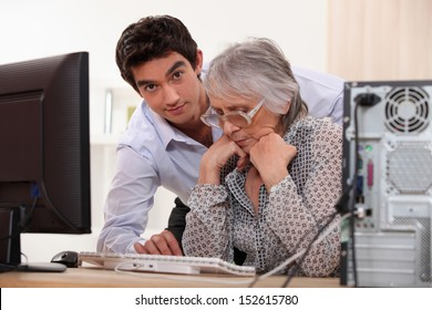 Grandson and grandmother with the computer