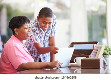 Grandson Helping Grandmother With Laptop