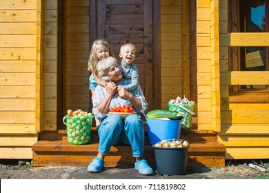 grandson hugging grandmother harvest season