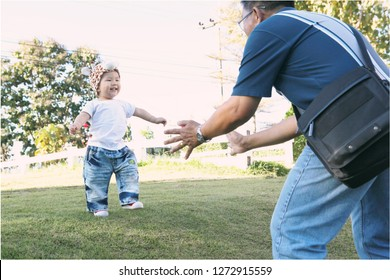 Grandson was walking to his grandfather happily , Cute Asian little boy playing having fun at park , old man taking care of a little child boy