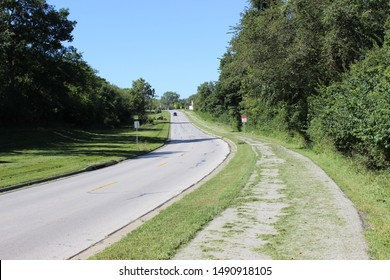 Grandview, Missouri / USA - August 28 2019: Grass from Recent Mowing Covering Truman Presidential Trail on Sunny Summer Day beneath Blue Sky