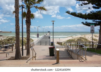 The grange jetty with a blue sky and white fluffy clouds looking from the esplande at Grange South Australia on 7th November 2018