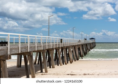 The grange jetty with a blue sky and white fluffy clouds at Grange South Australia on 7th November 2018