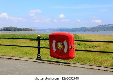Grange-Over-Sands Cumbria UK 07.14.2018 - A bright red box with telephone inside to contact the coastguard in case of emergencies along the estuary at Grange-Over-Sands UK