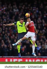 Granit Xhaka of Arsenal beats Laurent Depoitre of Huddersfield Town - Arsenal v Huddersfield Town, Premier League, Emirates Stadium, London (Holloway) - 8th December 2018