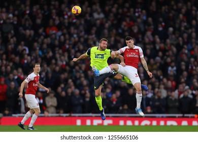 Granit Xhaka of Arsenal and Laurent Depoitre of Huddersfield Town - Arsenal v Huddersfield Town, Premier League, Emirates Stadium, London (Holloway) - 8th December 2018