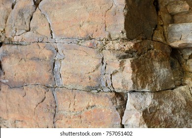 Granite background, plants in stone, abstract stone texture, environmental problems, tectonic plate fracture, earthquake consequences, cracks in granite rocks, granite pattern