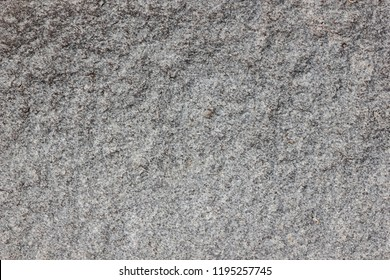 Granite background. Texture of gray granite stone. Natural pattern in gray tones. Abstract background