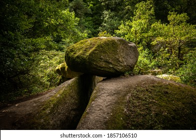 Granite boulders in the forest of Huelgoat (Brittany, France) on a cloudy day in summer