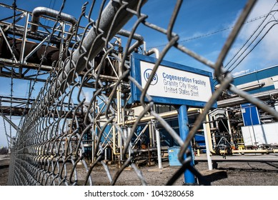 Granite City, Illinois, United States-March 10, 2018-US Steel Cogeneration Facility, Granite City Works, signage looking through chain link fence from road
