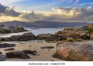 Granite costal rocks on Punta Cabalo cape in Arousa Island