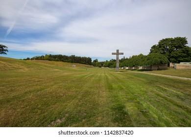 The Granite Cross of the Woodland Cemetery (Skogskyrkogarden), Stockholm, Sweden - 26 Jun 2018: In 1994, Skogskyrkogarden was named a UNESCO World Heritage Site.
