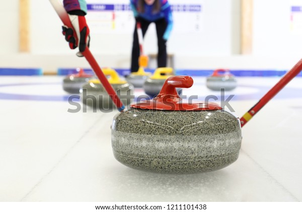 Granite curling stones.Curling on the ice. Team curling game.