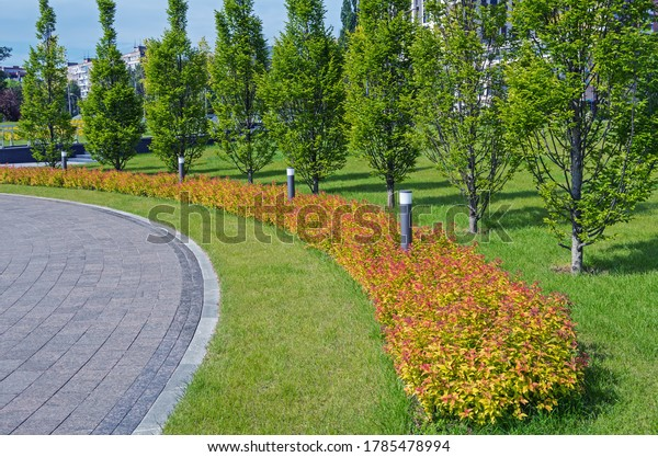 granite-footpath-bends-around-red-600w-1