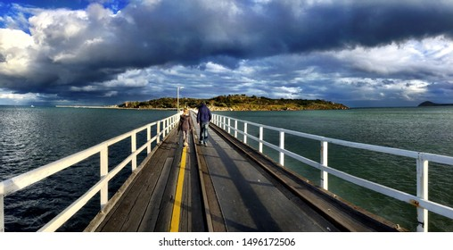 Granite Island Victor Harbor South Australia with people walking on Tram Causeway Bridge