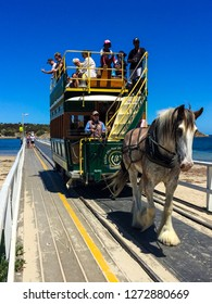 GRANITE ISLAND, VICTOR HARBOUR, SOUTH AUSTRALIA; 1 January 2019; A Clydesdale draws Australia's last horse-drawn tram across the causeway from Granite Island.