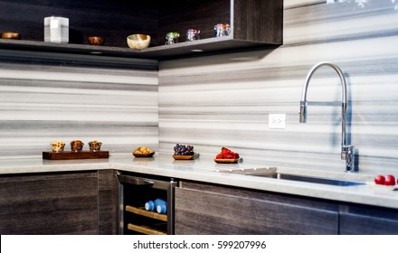 granite, kitchen counter with fruits and nuts on it