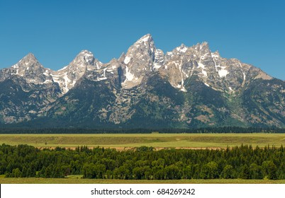 The granite peaks of Grand Teton national park towering above the great plains in the state of Wyoming, United States of America (USA).