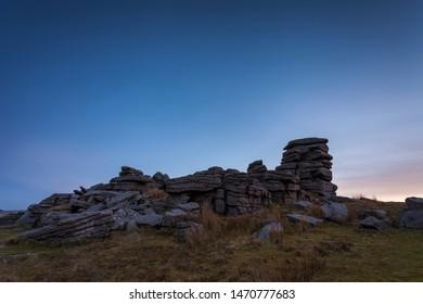 Granite rocks on Great Staple Tor, Dartmoor national park at dusk
