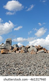 Granite and sandstone photographed against the cloudy sky