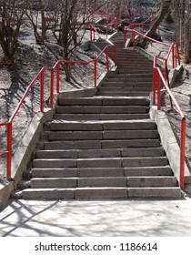 granite stairs with red railing