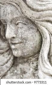 Granite statue of womans face