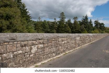 Granite Stone Wall along Bridge on Top of the Dam of Venford Reservoir within Dartmoor National Park in Rural Devon, England, UK