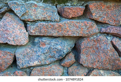 Granite stone wall texture. Close up.
