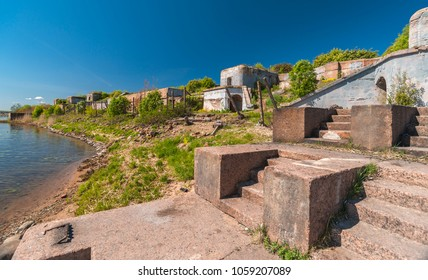 Granitic stairway to the abandoned Fort of the second world war in spring sunny day