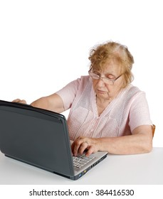 granny in glasses looks at the screen notebook on a white background