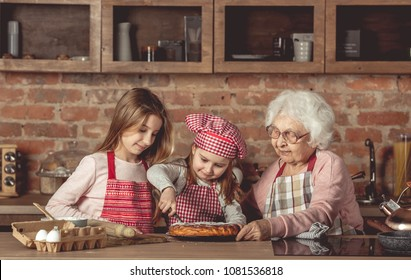 Granny with her granddaughters tasting pie
