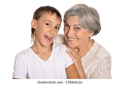 Granny hugging his grandson on white background