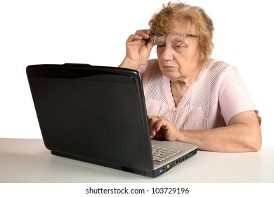 Granny with the laptop isolated on a white background
