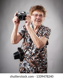 Granny photographer with old camera