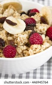 granola with banana, raspberries and raisins- nutritious breakfast
