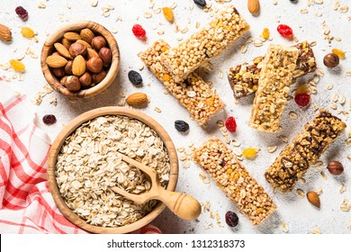 Granola bar. Healthy  snack. Cereal granola bar with nuts, fruit and berries on a white stone table. Top view.