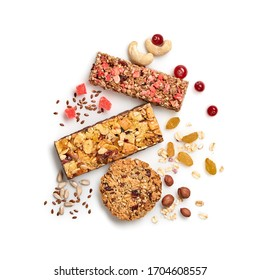 Granola bar with nuts and dry fruit berries. Cereal healthy snack. Fitness food. Protein muesli bars isolated on white background. Sport oatmeal bar, top view