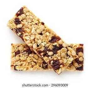 Granola bar with raisins isolated on white background