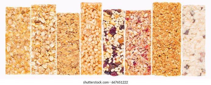 Granola bars with cereals and dried fruit isolated on white background, include clipping path