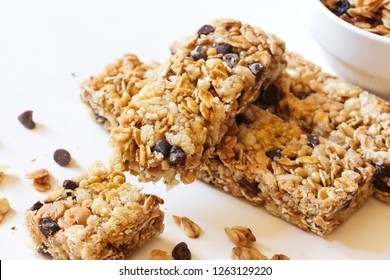 Granola bars close up on white background, selective focus