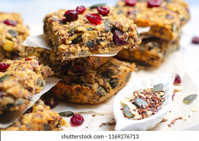 Granola Bars, Healthy Homemade Snack, Superfood Bars with Cranberry, Pumpkin Seeds, Oats, Chia and Flax Seed on bright background, Vegan Meal