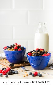 Granola with berries and milk