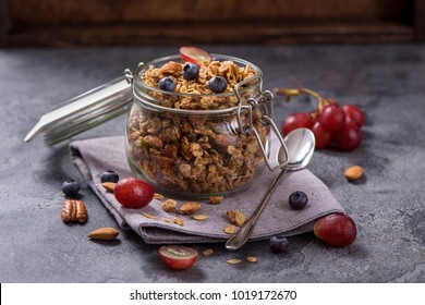 Granola with berries, nuts and seeds,  energy snack or healthy cereal  breakfast in mason jar