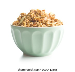 The granola breakfast cereals in bowl isolated on white background.